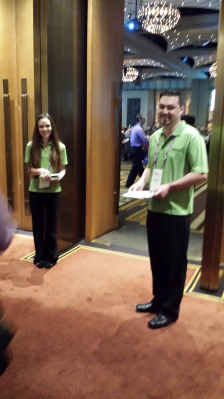 Back to work handing out brochures as over 1,000 people file in for the next session.